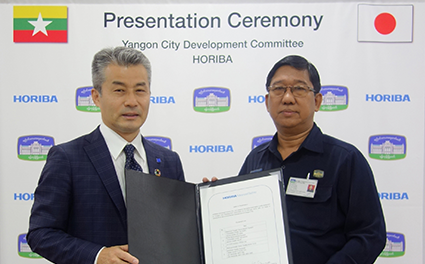 Koichiro Kanaya, Corporate Officer, HORIBA Advanced Techno (left), and Thein Min, Deputy Head, Water & Sanitation Department, YCDC